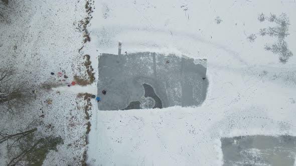 Children Slide Down The Slide In Winter