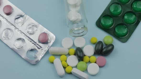 Thumbnail for Many Spinning Pills and Drugs. Pills and Tablets, Blister Packs Turning