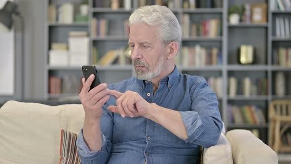 Old Man Using Smartphone
