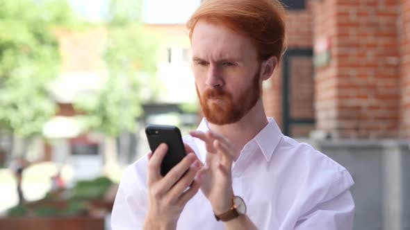 Thumbnail for Man Using Smartphone while Standing Outside Building