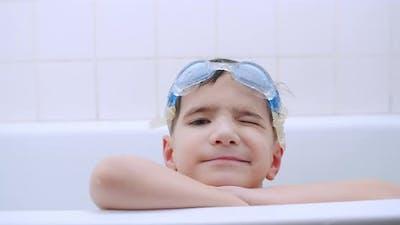 Boy Winking in Bathtub