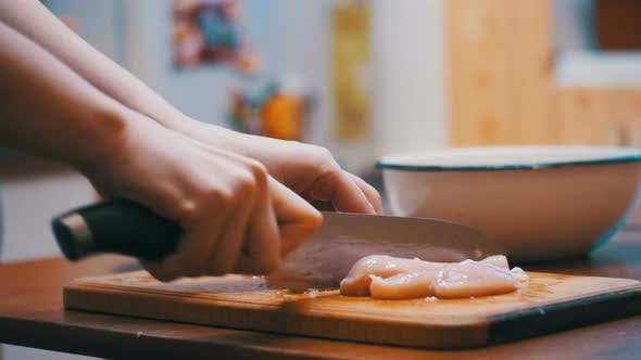 Thumbnail for Hands Cutting Fresh Meat, Cutting Meat on a Kitchen Board, Cutting Raw Meat