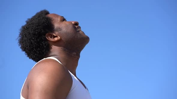 Cover Image for Side View of Exhausted Sportsman Wiping Sweat After Workout Outdoor