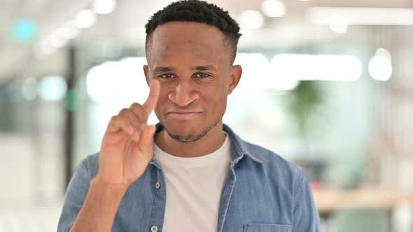Thumbnail for Portrait of Casual African Man Saying No with Finger Gesture
