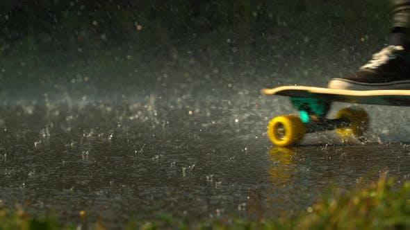 Thumbnail for Longboarding in the rain, slow motion