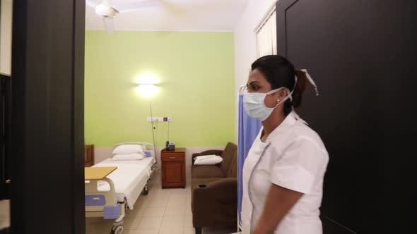 Indian Nurse Opens A Hospital Bed Room
