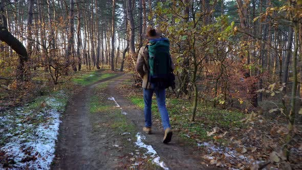 Thumbnail for Backpacker Walks Along a Trail in the Forest