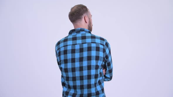 Thumbnail for Rear View of Bearded Hipster Man Thinking and Waiting