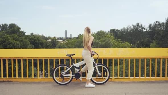 Thumbnail for Girl Riding Bicycle