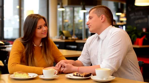 Thumbnail for Happy Couple Talk in Cafe, Couple Holding Hands, Coffee and Cake