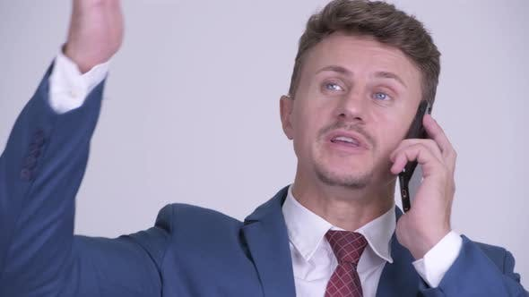 Thumbnail for Face of Happy Bearded Businessman Talking on the Phone
