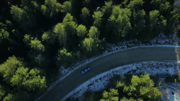 Thumbnail for A Car Is Riding Through the Forest in Canada
