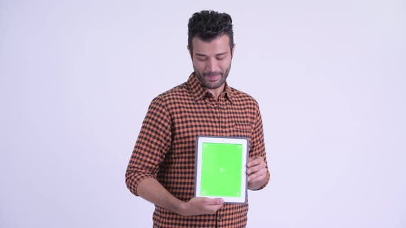 Thumbnail for Happy Bearded Persian Hipster Man Thinking While Showing Digital Tablet