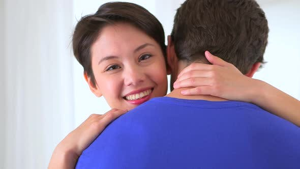 Thumbnail for Happy Chinese woman hugging her boyfriend