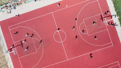 Aerial View of Young Athletes Playing Streetball on an Outdoor Public Basketball Court