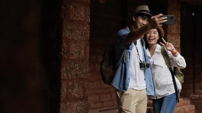Couple selfie on smartphone in ancient temple