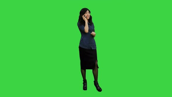Thumbnail for Beautiful Chinese Ssian Woman Talking on Mobile Phone on a Green Screen, Chroma Key