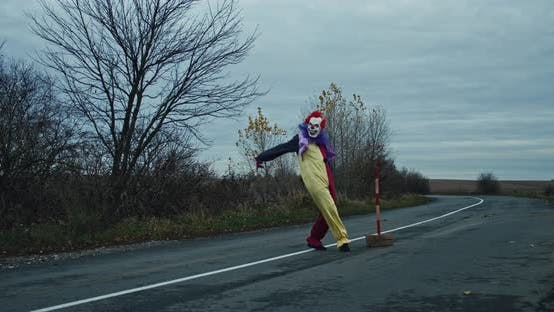 A Scary Clown Is Dancing On The Road