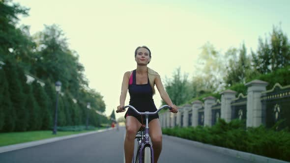 Thumbnail for Athlete Woman Riding Bicycle in Summer Park. Sport and Active Lifestyle