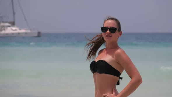Young Woman in a Bikini Posing on Exotic Beach at the Turquoise Ocean Zanzibar