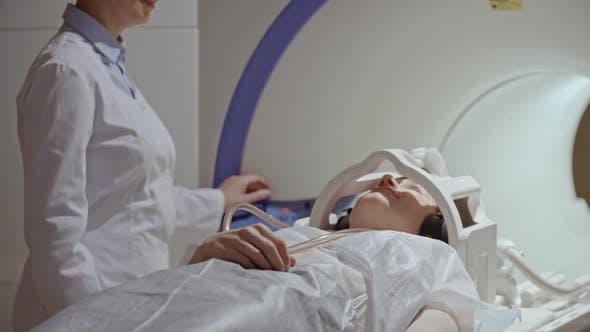 Thumbnail for Radiologist Performing MRI Examination of Woman