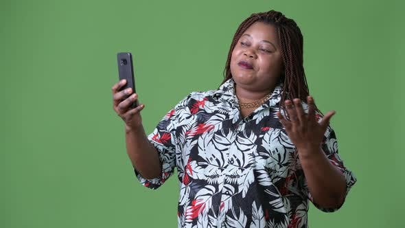 Thumbnail for Overweight Beautiful African Woman Against Green Background
