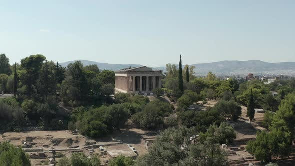Slow Aerial Dolly Movement Towards Typical Greek Temple Ruins in Athens, Greece at Daylight