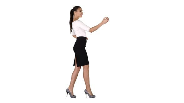 Thumbnail for Pretty girl taking a selfie and walking on white background