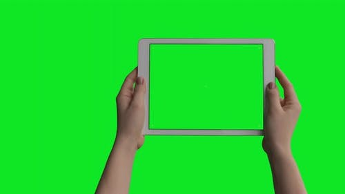 iPad Air Tablet In Female Hands isolated on green screen background with alpha channel luma matte.