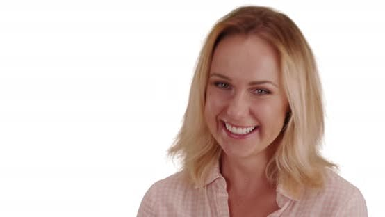 Close-up of cheerful white woman laughing happily on solid white background