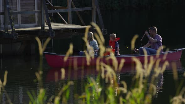 Family paddling canoe