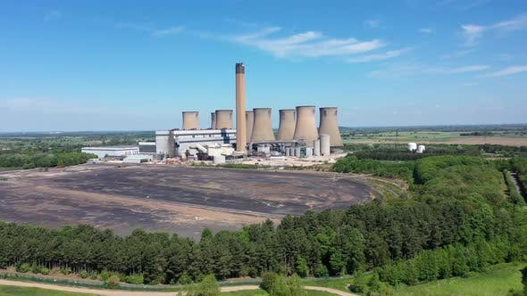Aerial footage of the Eggborough Power station showing the eight cooling towers and chimneys in UK