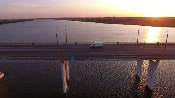 Thumbnail for Aerial Shot of Large Bridge with a Moving Minibus at Golden Sunset in Summer