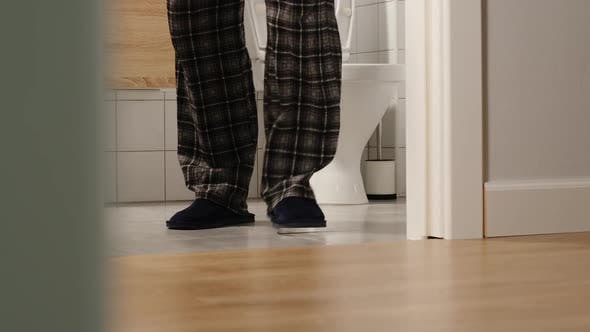 Thumbnail for Adult man runs to a toilet at home