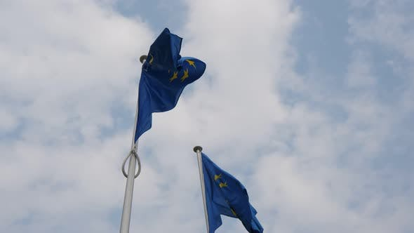 Thumbnail for Two EU Banners Waving in the Light Blue and White Air in Brussels in Spring