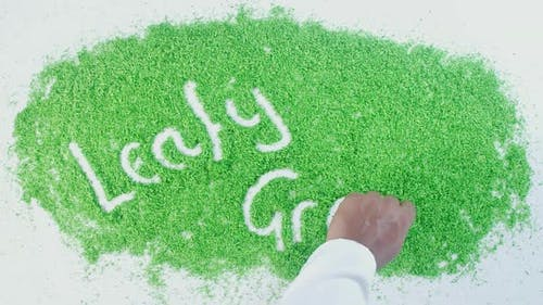 Green Hand Writing Leafy Greens