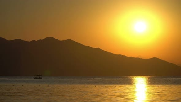 Thumbnail for Boat At Sunrise Mountains Background