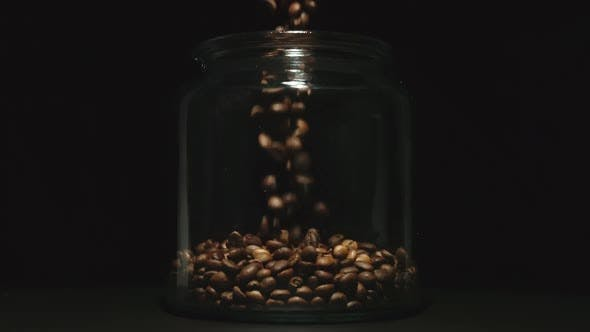 Thumbnail for Slow Motion Coffee Beans Pouring Into A Glass Jar