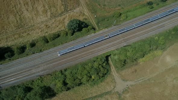 Birds Eye View of a Fast Commuter Train in the Countryside