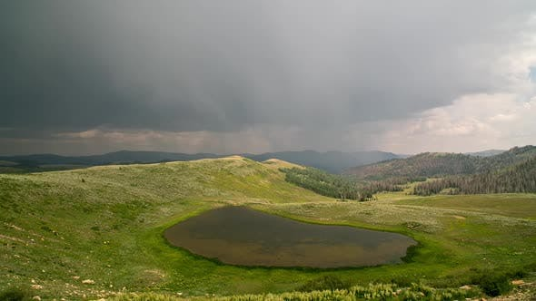 Timelapse of rain storm moving through the mountains