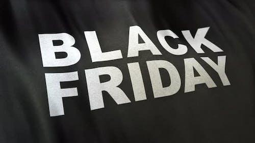 Black Friday slogan in white letters on full-frame black satin textured flag