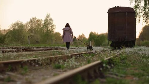 Cute Woman Walking Her Dog at Old Abandoned Railway