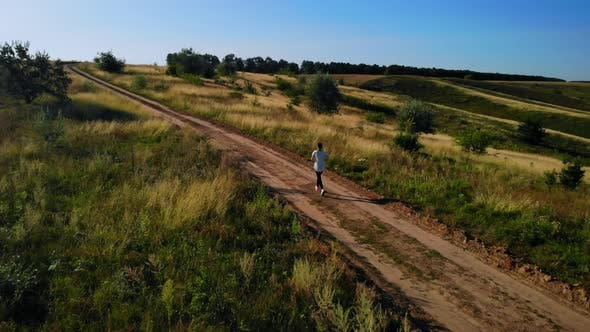 Thumbnail for Aerial View on Woman Jogging on Countryside
