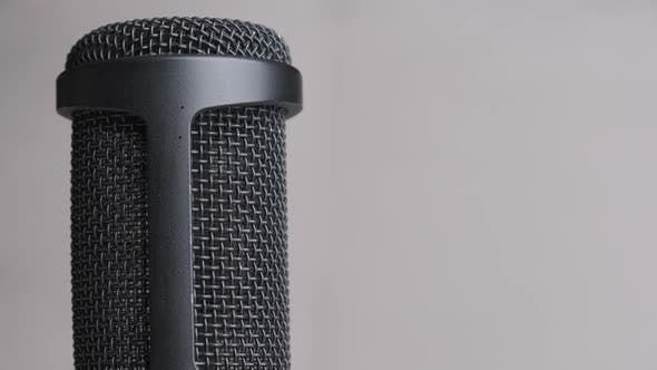 Thumbnail for Studio Condenser Microphone Rotates on Gray Background with Place for Text