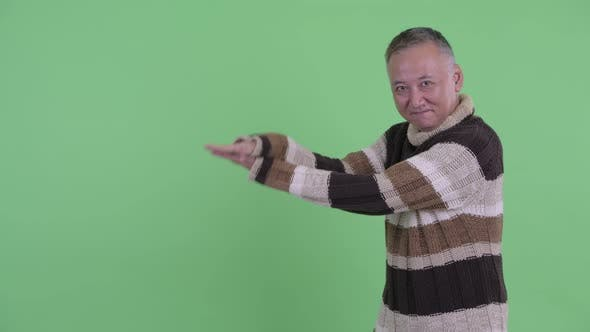 Thumbnail for Happy Mature Japanese Man Snapping Fingers and Showing Something