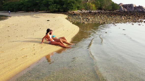 Beautiful women look beautiful on beautiful coastline beach wildlife by blue water with white sandy