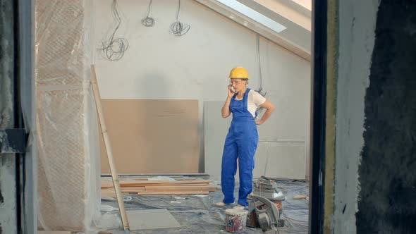 Thumbnail for Woman Builder On Site Using Mobile Phone