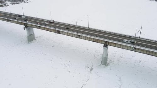 A Stream of Cars Moves Through the Tomsk Road Bridge