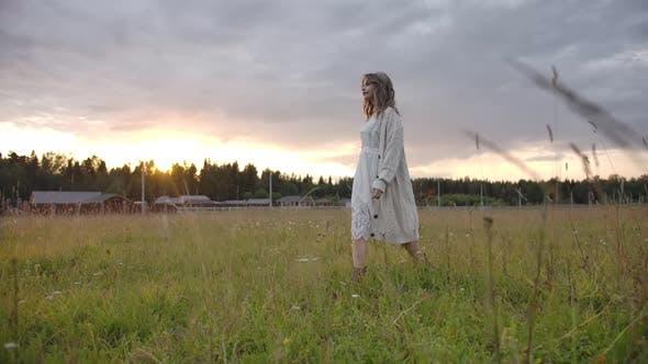 Thumbnail for Sensual Woman in White Dress Walking in Field Near Farm