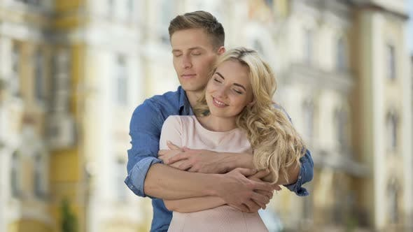 Cover Image for Male Hugging His Girlfriend from Behind, Kissing His Sweetheart, Tenderness